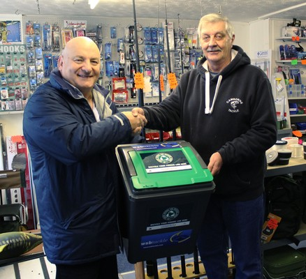 WSB general manager Mario (left) delivering one of the ANLRS bins to Camborne Tackle owner Graham