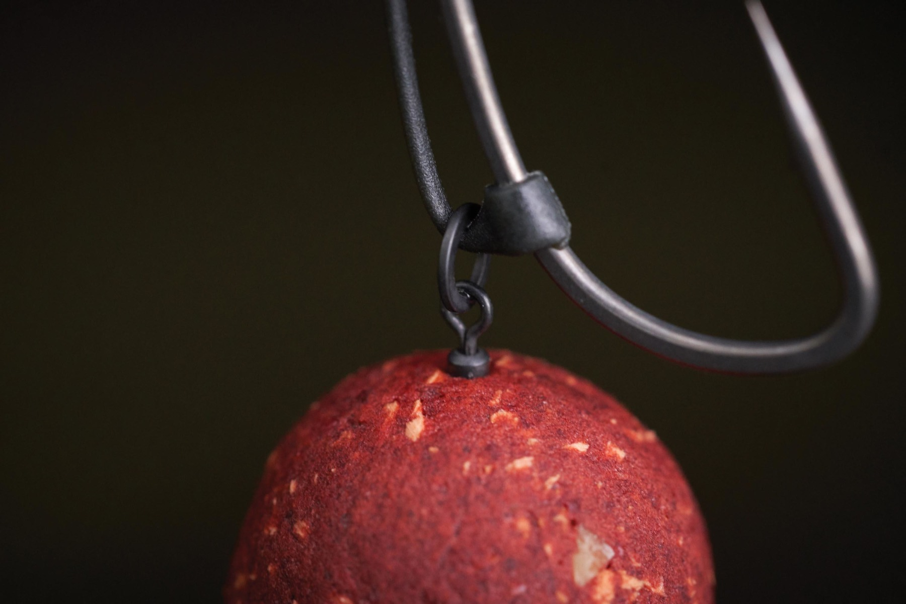 The base of the extended 'D Rig Kicker' is positioned opposite the barb. As Phil touches on, he uses a couple of different tools to mount his hookbait, from a mini Hook Swivel, to a rig ring, to a Hookbait Screw.