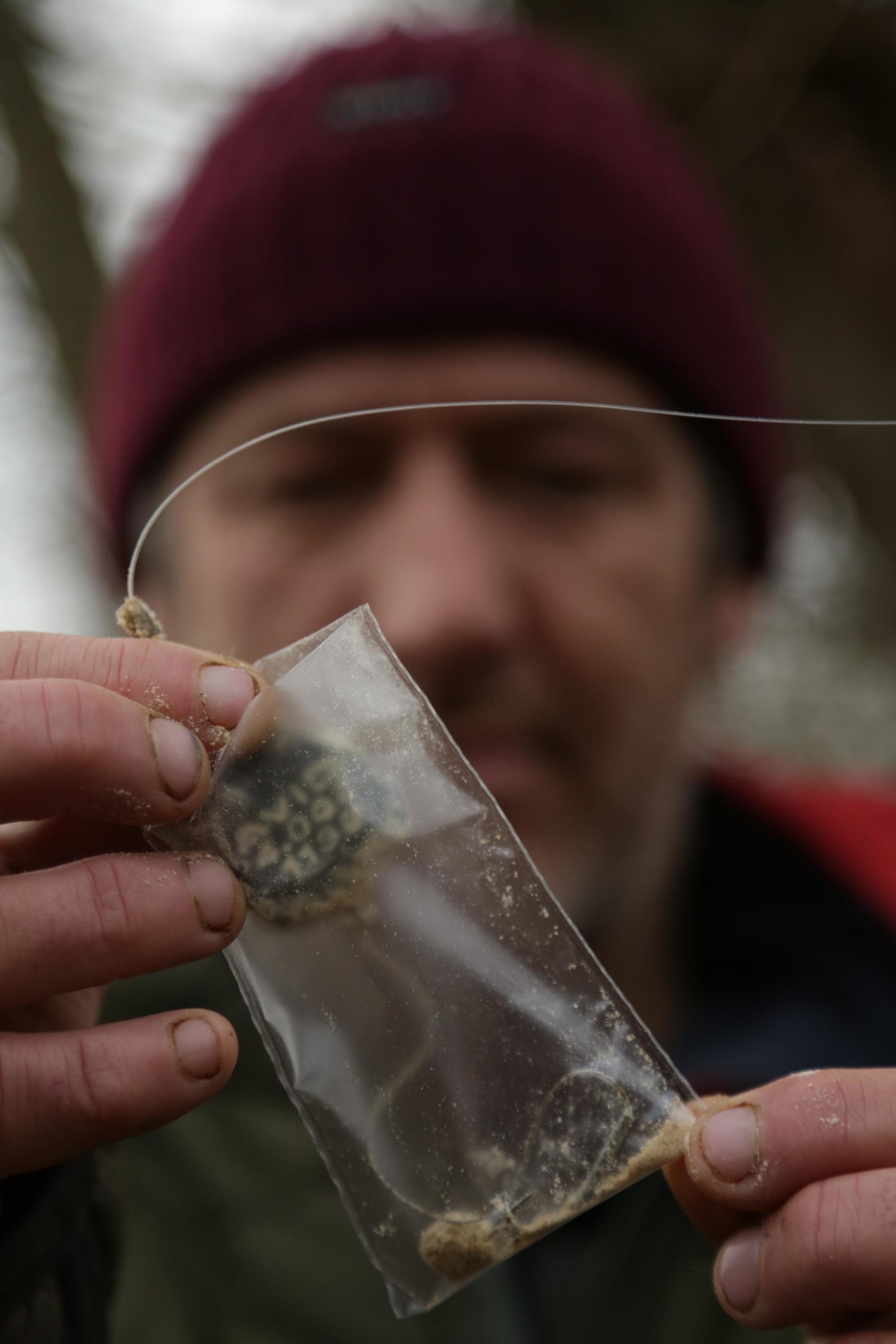 2. Next add a few 3mm Bloodworm Pellets.